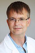 Herr Dr. med. Justus Faust