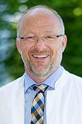 Herr Dr. med. Martin Emlinger